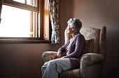 Shot of a senior woman sitting alone in her living room