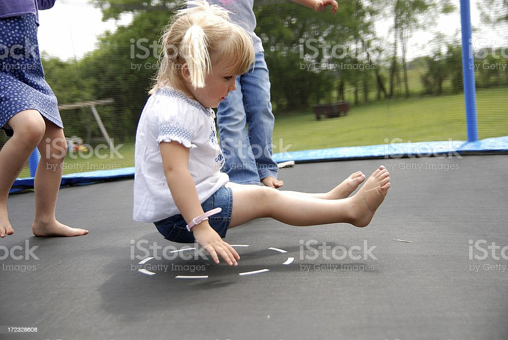 Being Bounced on the Trampoline stock photo