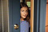 istock Being Cautious While Opening Front Door 1221500611