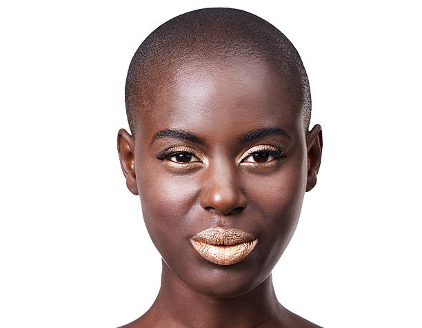 Being fabulous is the best revenge! Studio shot of a beautiful young african woman isolated on whitehttp://195.154.178.81/DATA/i_collage/pi/shoots/783626.jpg shaved head stock pictures, royalty-free photos & images