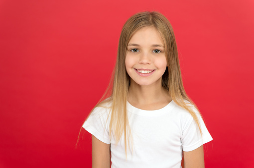 Being natural is more stylish. Cute little fashion model. Little girl of fashion. Fashionable girl child. Small girl with fashion look. Little girl with long blond hair in fashion style, copy space.