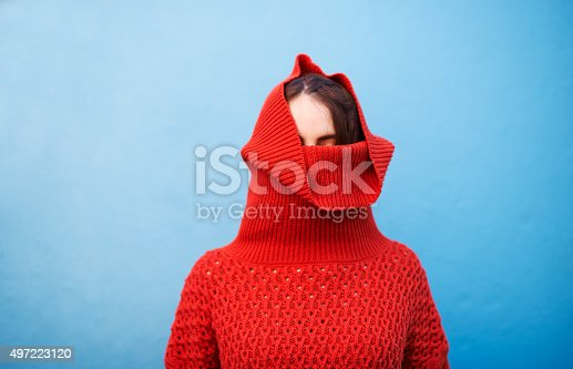 Shot of a young woman pulling her sweater over her headhttp://195.154.178.81/DATA/i_collage/pu/shoots/805920.jpg