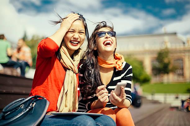 stato esterno - two students together asian foto e immagini stock