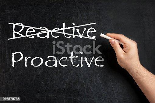 Being Proactive not Reactive crossed on blackboard or chalkboard