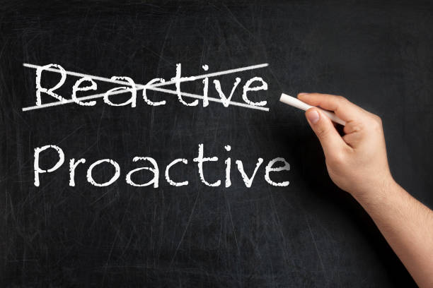 Being Proactive not Reactive crossed blackboard chalkboard stock photo