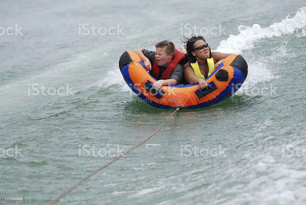 Being Splashed on the Inner tube stock photo