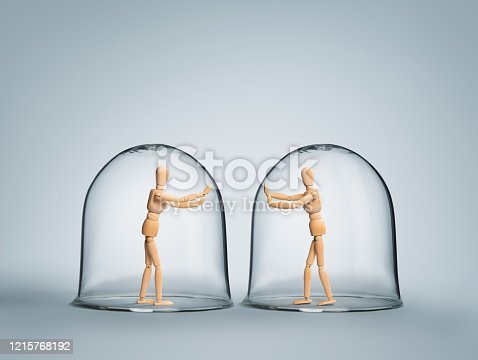 Human puppets each in it's own glass bubble expressing love while being apart from each other