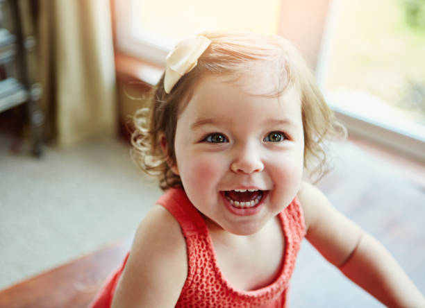 being young means enjoying days full of fun - baby girls stock photos and pictures