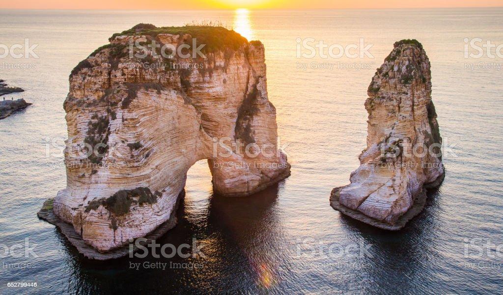 Beirut pigeon rocks. Sea sunset background. stock photo