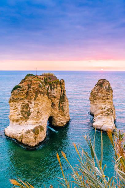 beirut sunset on raouche rocks - beirut стоковые фото и изображения