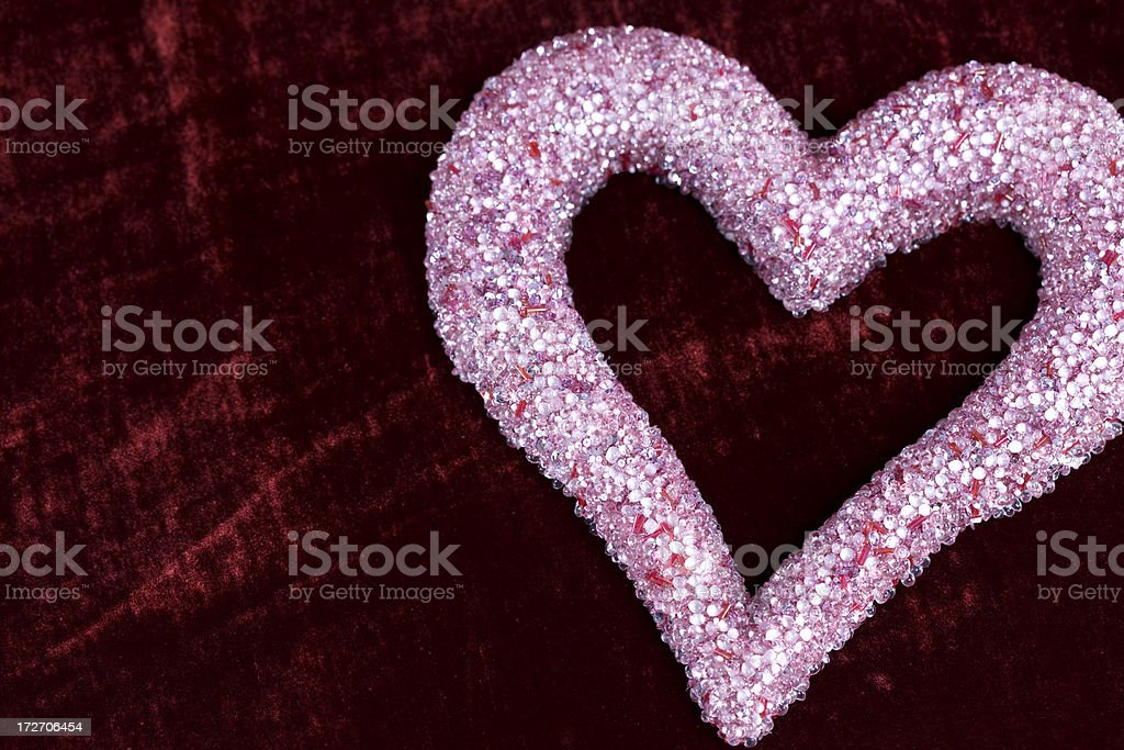 Bejeweled Pink Heart Shape on Red Velvet, Copy Space royalty-free stock photo