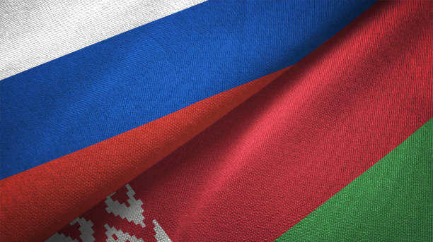 belarus and russia two flags together realations textile cloth fabric texture - białoruś zdjęcia i obrazy z banku zdjęć