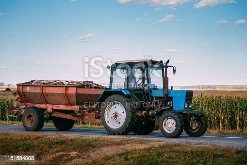 Malyye Avtyuki, Belarus - September 9, 2016: Tractor The MTZ-82 The Belarus On Country Road. Belarus - a Brand Of Universal Wheeled Tractor Wheels Produced By The Minsk Tractor Plant From 1974 To The Present