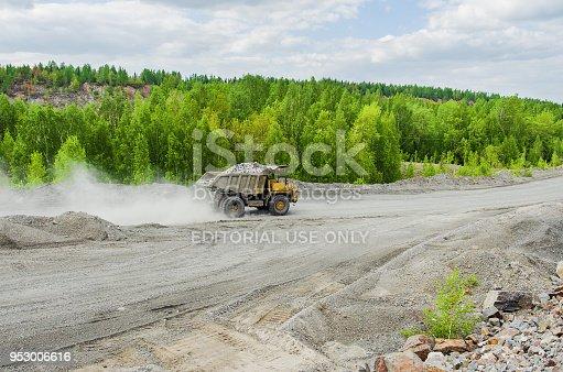 istock BelAZ truck transports ore on a dirt road 953006616
