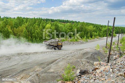 istock BelAZ truck transports ore on a dirt road 953006620