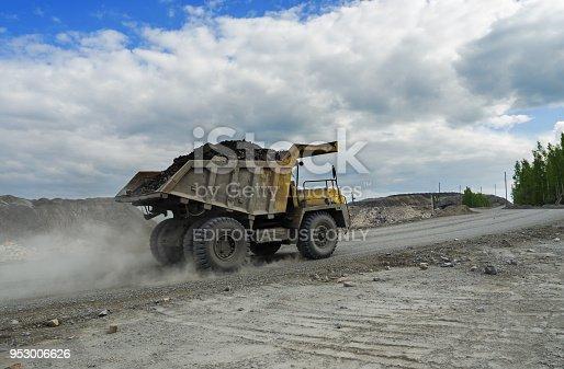 istock BelAZ truck transports ore on a dirt road 953006626