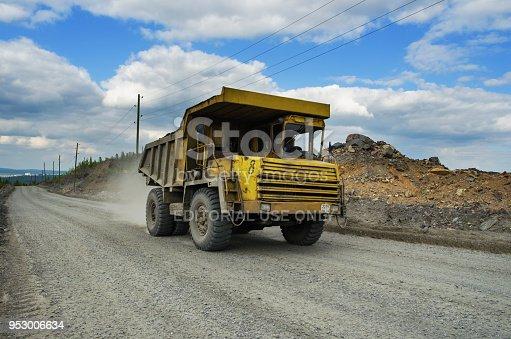 istock BelAZ truck transports ore on a dirt road 953006634