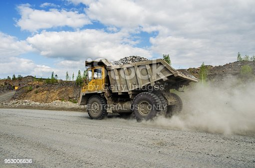 istock BelAZ truck transports ore on a dirt road 953006636
