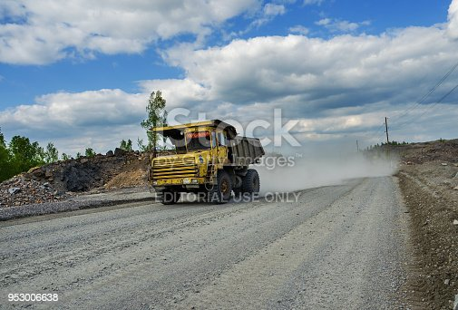 istock BelAZ truck transports ore on a dirt road 953006638