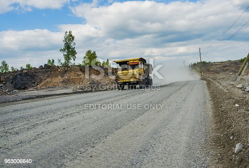 istock BelAZ truck transports ore on a dirt road 953006640