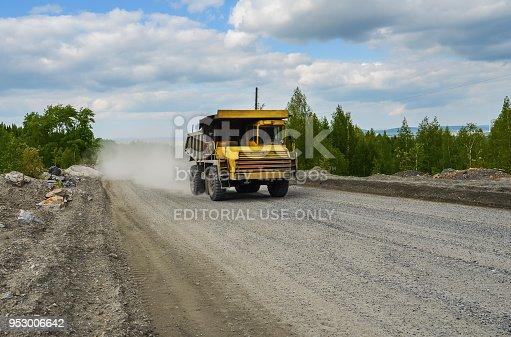 istock BelAZ truck transports ore on a dirt road 953006642