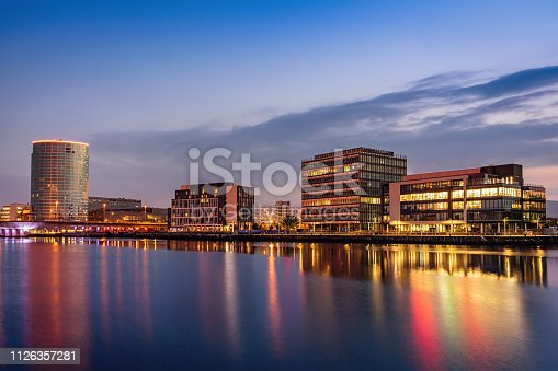 Belfast Cityscape at City Quays reflecting in the River Lagan at Twilight. City Quays, River Lagan Waterfront, Belfast, Northern Ireland, UK