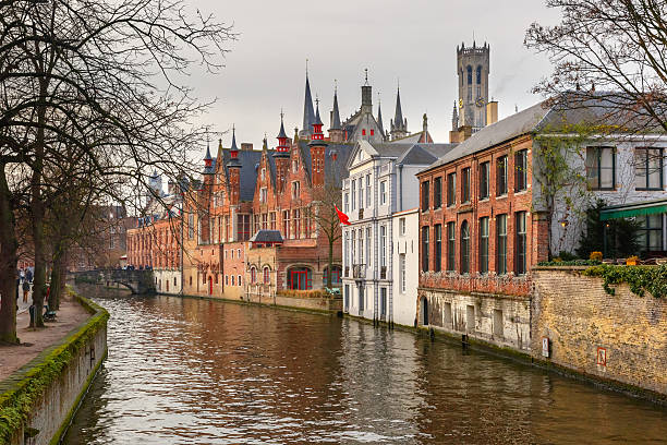 Belfort and the Green canal in Bruges, Belgium Scenic winter cityscape with a medieval tower Belfort and the Green canal, Groenerei, in Bruges, Belgium bell tower tower stock pictures, royalty-free photos & images