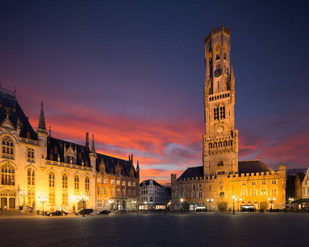 belfry Belfort of Bruges and Grote Markt square, Belgium. Belfort van Brugge -  famouse 12th-century belfry Belfort of Bruges and Grote Markt square, Belgium. bell tower tower stock pictures, royalty-free photos & images