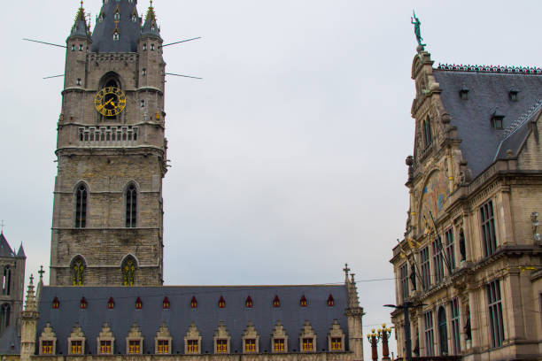 Belfry (Het Belfort) of Ghent, Belgium, Europe. Medieval 91-meters bell tower in the old town of Ghent Belfry (Het Belfort) of Ghent, Belgium, Europe. Medieval 91-meters bell tower in the old town of Ghent bell tower tower stock pictures, royalty-free photos & images