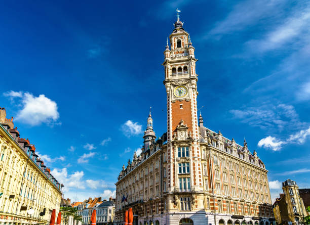 belfry of the chamber of commerce. a historic building in lille, france - колокольня стоковые фото и изображения