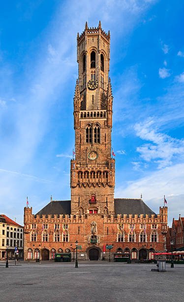 Belfry Tower in Bruges, Belgium Front view of Belfry Tower, Bruges, Belgium bell tower tower stock pictures, royalty-free photos & images