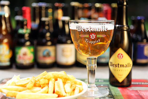 Belgian Beer Westmalle Trappist Tripel and Belgian Fries stock photo