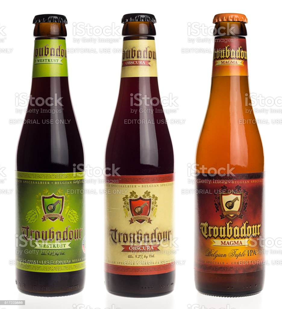 Belgian beers Troubadour Westkust, Obscura and Magma isolated on white stock photo