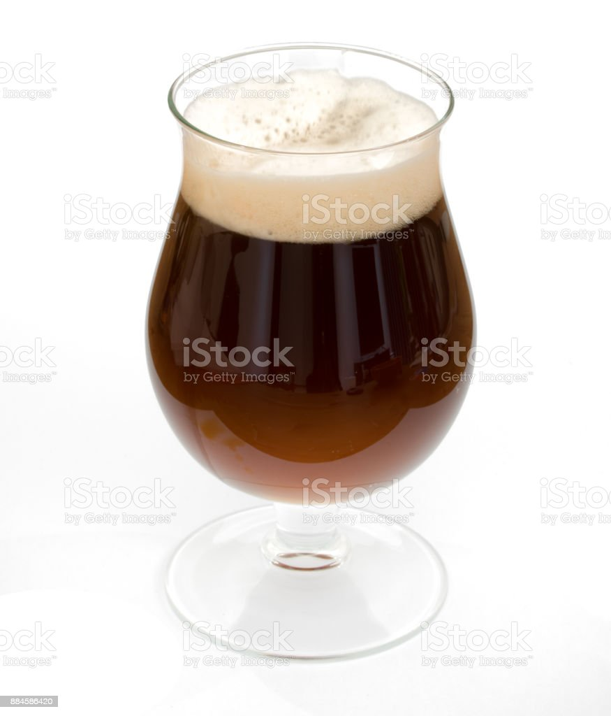 Belgian black beer in chalice glass isolated stock photo