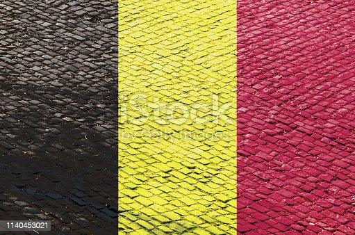 istock Belgian Flag on a Cobblestone Road 1140453021