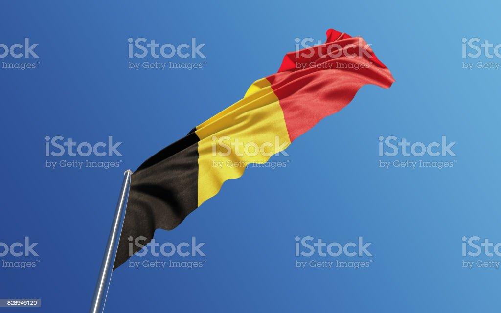 Belgische vlag zwaaien met Wind op blauwe hemel foto