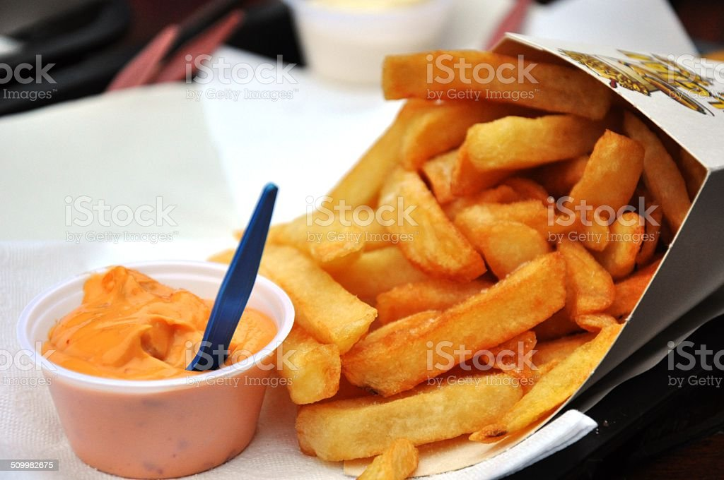 Belgian fries with samurai sauce stock photo