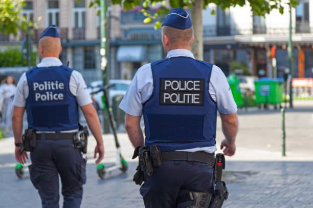 Belgian policemen in bulletproof vests stock photo