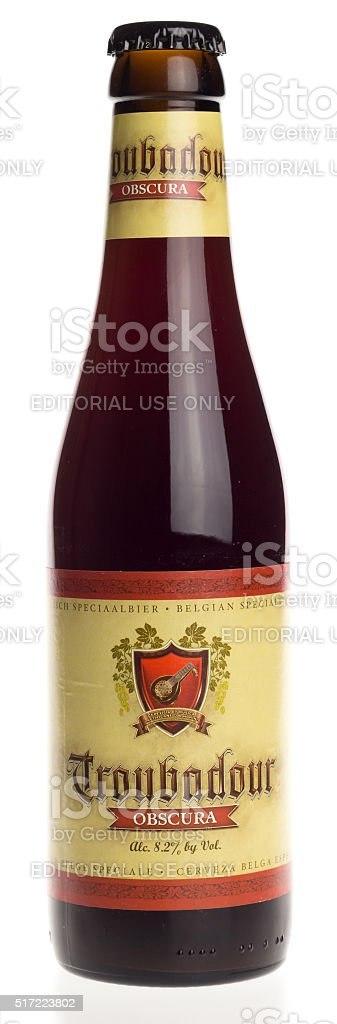 Belgian stout beer Troubadour Obscura isolated on white stock photo