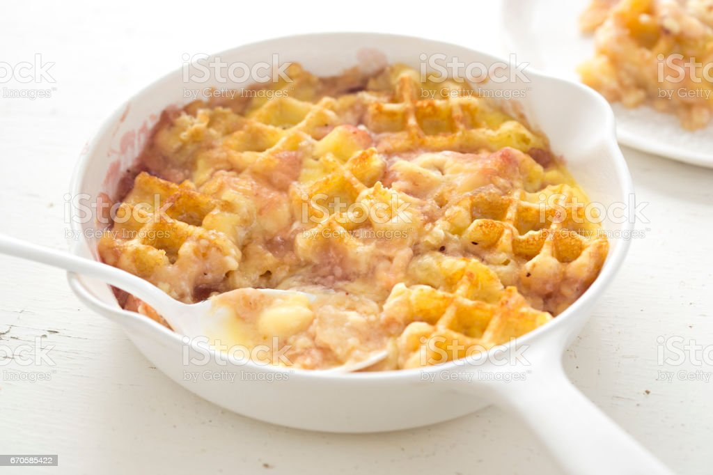 Belgian style waffle pudding with apple blueberry compote stock photo