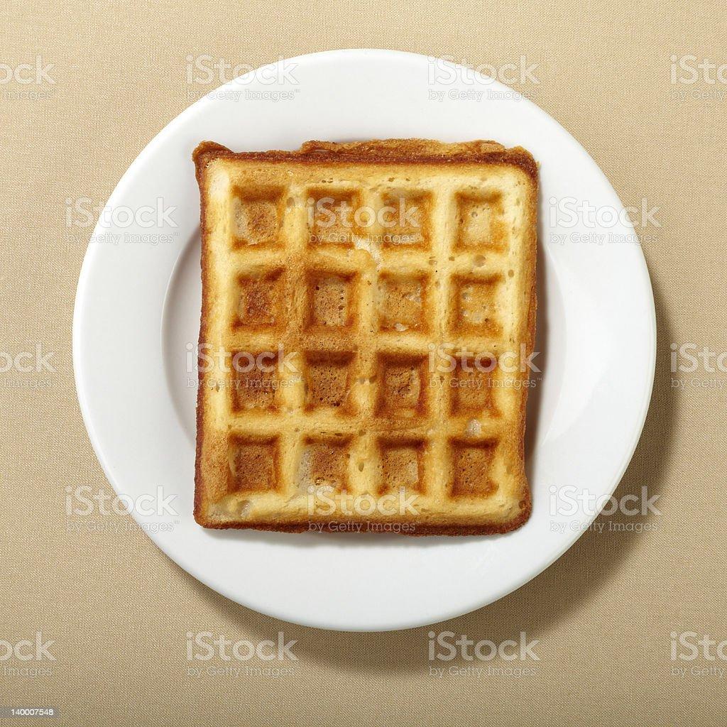 Belgian waffle on white plate stock photo