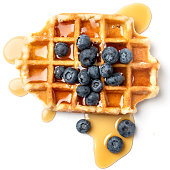 Belgian waffle with berries close up full length on white background