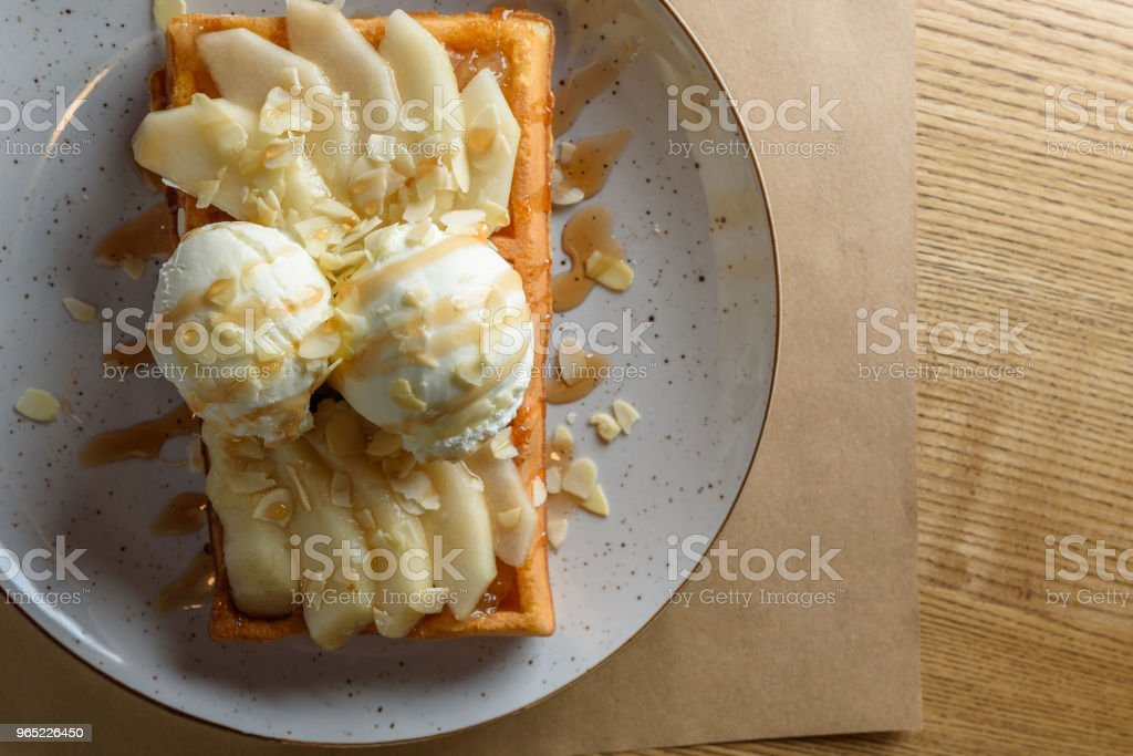 Belgian waffle with ice cream, caramel. With copy space for text, template or mockup royalty-free stock photo