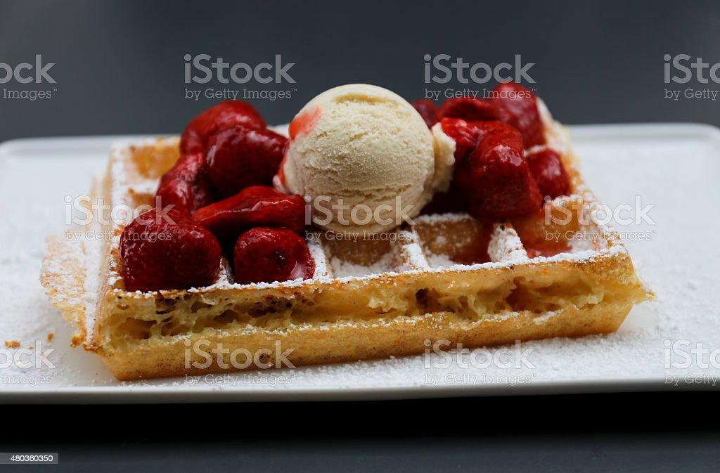 Belgian Waffle with Strawberries and Ice Cream stock photo