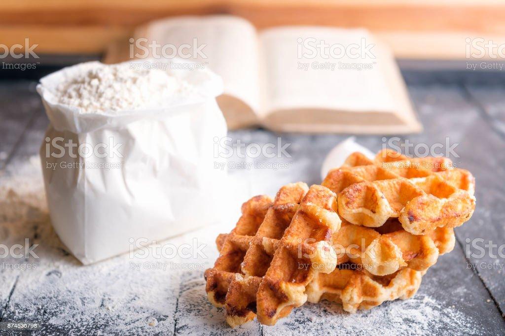 Belgian waffles and bag of flour stock photo