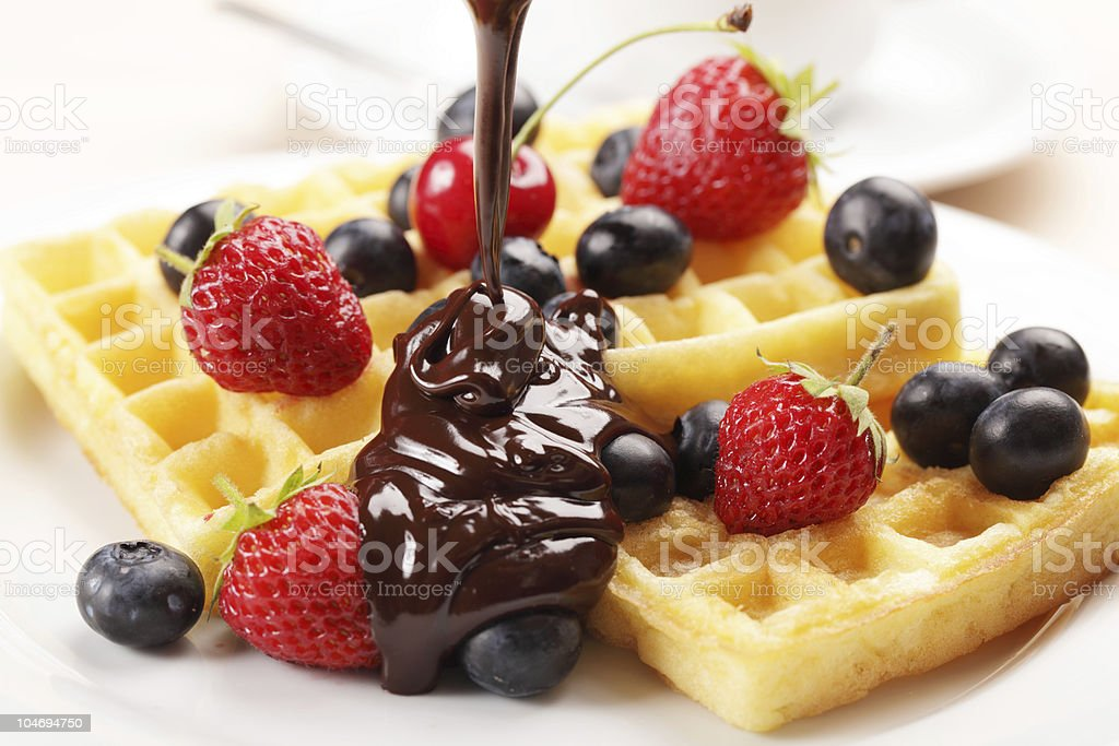 Belgian waffles topped with fruit royalty-free stock photo