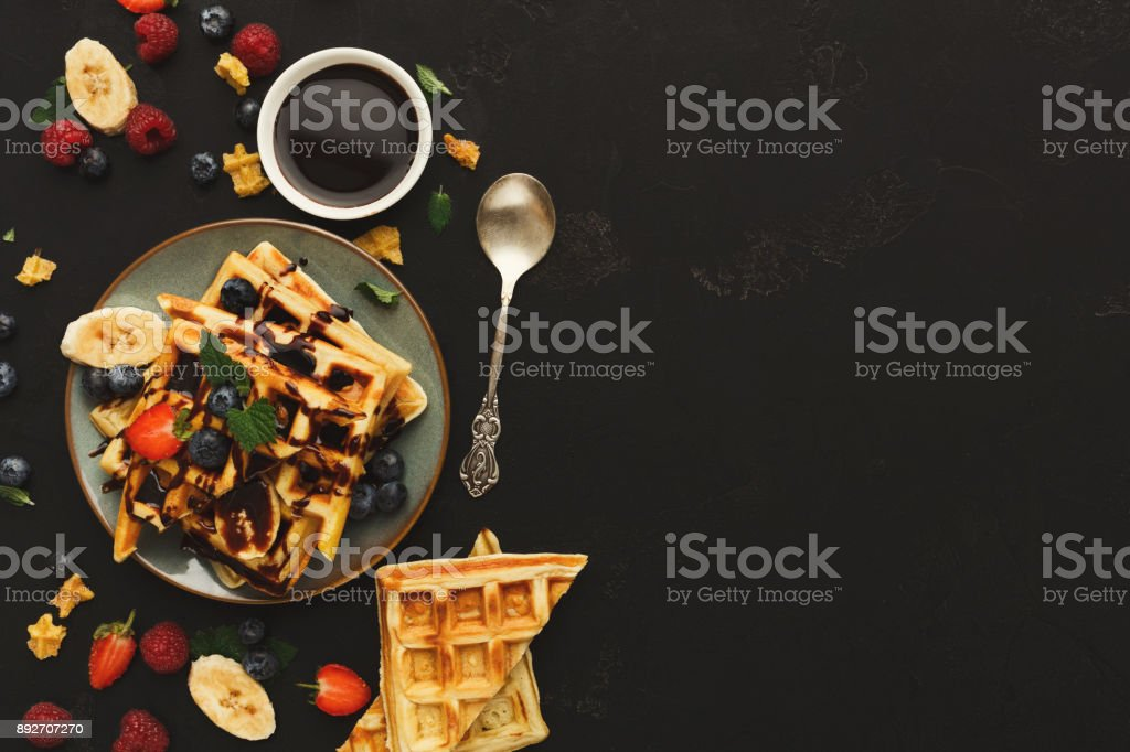 Belgian waffles with berries and fruits copy space stock photo