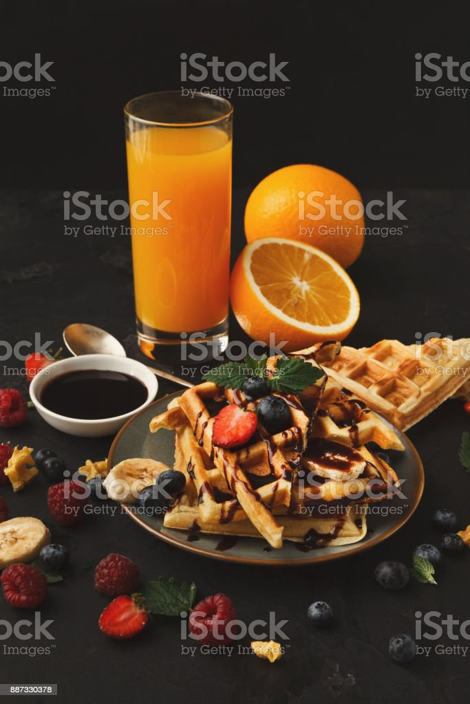 Belgian waffles with berries and fruits stock photo