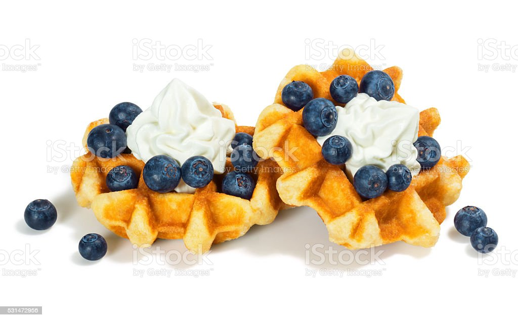 Belgian (Liege) Waffles with Blueberries and Whipped Cream stock photo