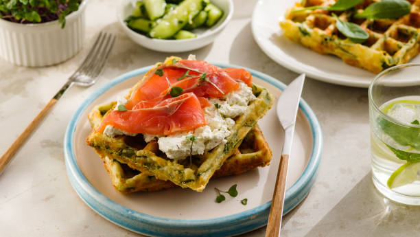 Cтоковое фото Belgian waffles with cheese and salmon. Healthy breakfast with ricotta and fish